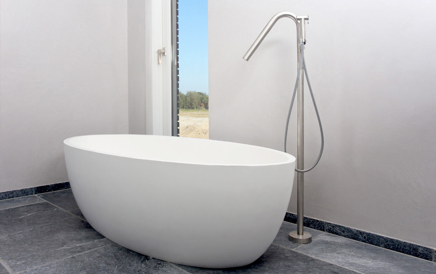 cocoon-large-bathtub-large-tub-design-tub-bath-column-stainless-steel-bath-mixer-grey-tiles-bathroom