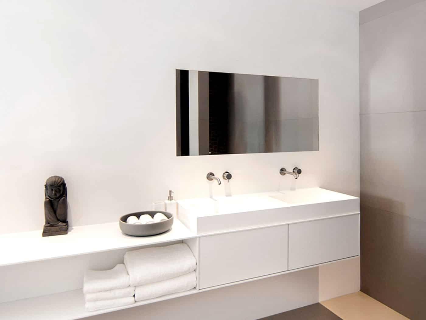 cocoon_minimalist_bathroom_corian_wash_basin_modern_taps_designer